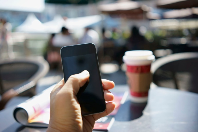 using mobile phone in a cafe